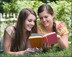 two-caucasian-girls-with-book