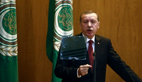 Turkey's PM Erdogan speaks during the opening session of Arab League's foreign ministers meeting at the League headquarters in Cairo