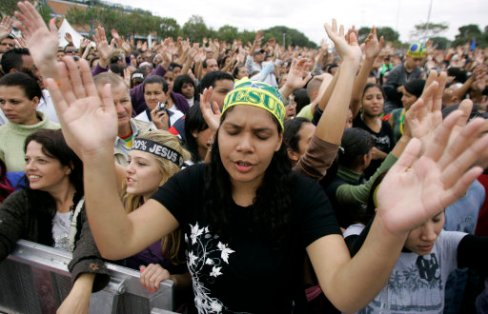 Evangelical protestants pray during the annual March for Jesus in Sao Paulo, Thursday, June 3, 2010. More than one million people attended the event, organizers said. (AP Photo/Nelson Antoine)